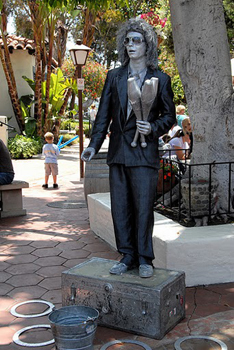 Silver Statue Juggling Busker at Seaport Village in San Diego