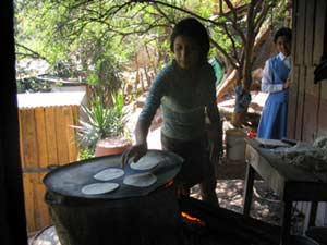 Cooking tortillas, in the Honduran tradition.