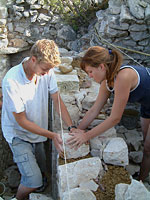 Volunteers work on a castle wall at La Sabranenque - photo courtesy of LaSaranenque