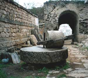 An ancient millstone at the entrance to Yao Zi Yu