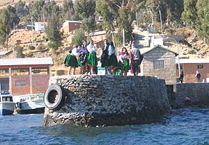Aymara women on the dock on Amantani Island