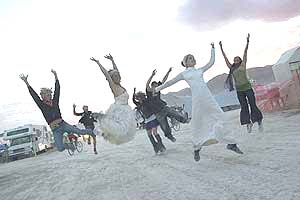 Photo by David Peterman of Jumping Brides at Burning Man 2005