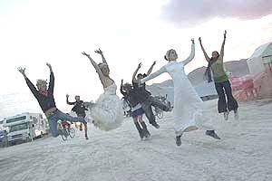 Photo by David Peterman of Jumping Brides at Burning Man 2005