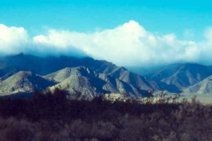 Clouds top the mountains that surround Vallecito after a spring rain.