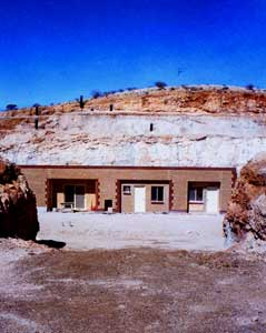 """Half of Coober Pedy's residents live in underground """"dugout"""" homes."""
