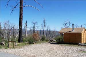 The Manzanita Cabin site offers some creature comforts and a stinging reminder of the fires last fall.