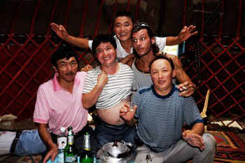 Merry local Kazak men with the author. Notice that the man on the far left appears to have passed out!