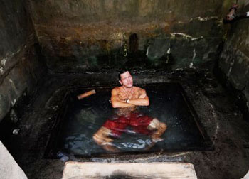 The author having a 'medicinal' soak in the tepid hot-spring