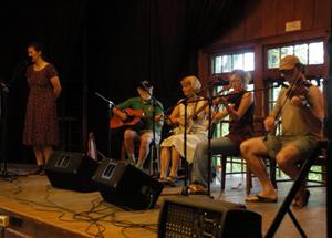 Musicians play at the folk school.