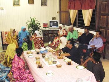 Village families open their homes for Hari Raya Aidilfitri.