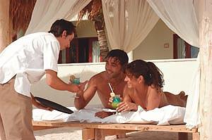 Enjoying the beachside bar service in a palapa at Desires.