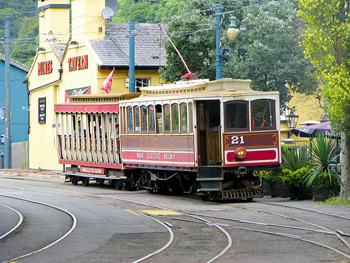 A train on the Manx Electric Railway clanks into the station at Laxey.