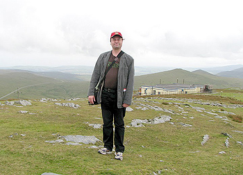 The author with his head in the clouds on the mountain of Snaefell, Isle of Man. (Photograph: Joyce Marsland)