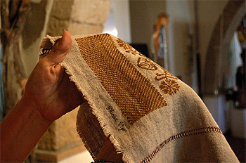 Detail of the byssus woven into a design on the fabric.