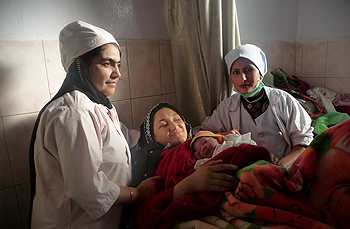 Afghan midwives and mother