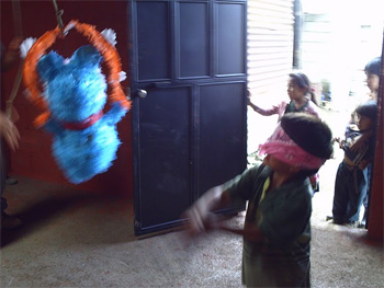 Celebrating the completed house with a pinata party.