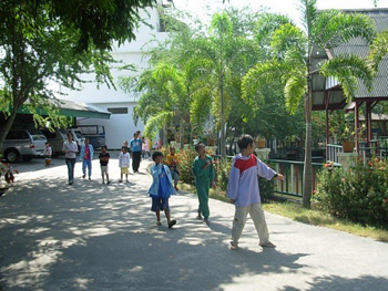 The beautiful courtyard of the Center with the children going to lunch.
