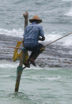 Man fishing on pole.