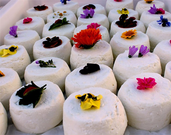 A farmers cheese decorated with edible flowers at the market in Corsica.
