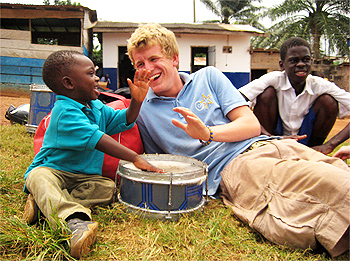A Projects Abroad volunteer entertains children in Ghana.