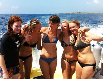 The author, center, about to lead her first group of divers as part of her divemaster certification.