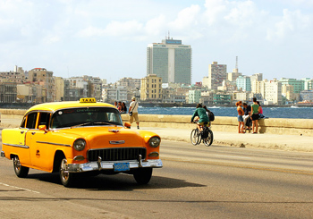 Vintage cabs are part of the street life in Cuba.