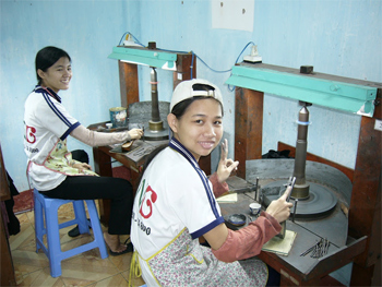 Disabled youth working on stoneware projects at the Nguyen Nga Center in Quy Nhon, Vietnam.