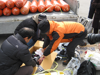 Boxes are filled with colorful socks, to be shared by the lucky finders in North Korea.