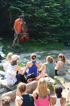 Garth Stevenson plays his cello on a mountain hike.