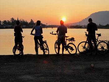Cyclists enjoying the Cambodian sunset