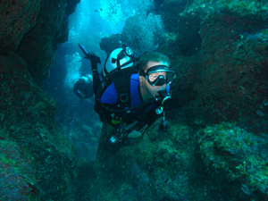 Phil navigates cliffs around Black Rock 1 dive site