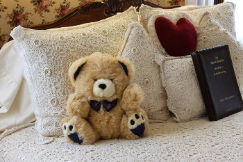 Most rooms in the Palmer House Inn greet you with a plush teddy bear on the bed