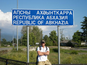 Lee Abbamonte at the border of Abkhazia. Picking lesser known destinations is one way to save a lot of money while traveling.