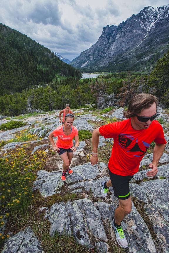 Runners trekking up a mountain in Montana.