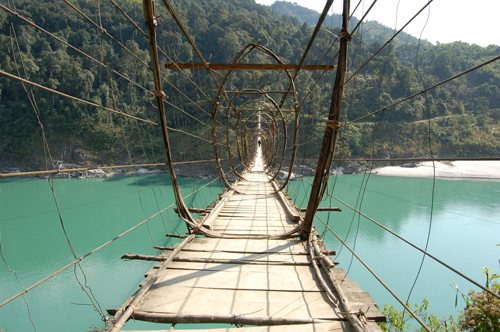 Cross a suspension bridge over the Siang River