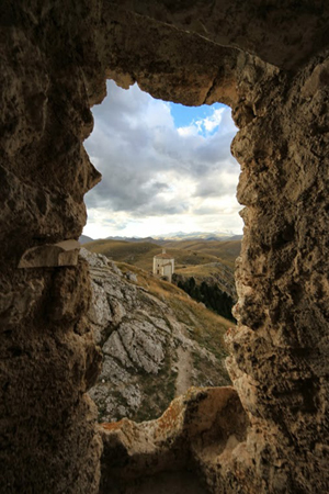 Not far from Castel Del Monte is a castle perched on the very top of what can only be described as a mountain. Beside that castle is a chapel. Photo by Adam Eagle.