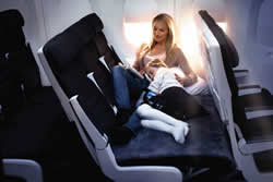 Air New Zealand's economy SkyCouch...make a bed from three seats!