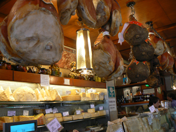 Hanging proscuitto at Tamburrini, in Bologna.