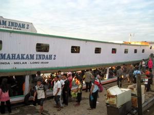 Boarding the longboat in Balikpapan, Borneo.