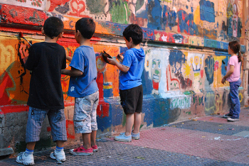 Kids painting a mural.