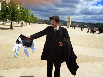 A proud graduate of Coimbra University with the ribbons denoting his major.