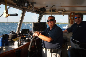 Captain Mike Kiernan in the pilot house.
