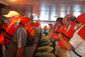 Passengers learn safety practices aboard the vessel.