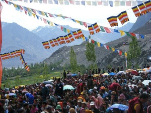 Prayer flags flutter high over the gathering crowd in Ladakh, in the Himalayas. photos by Katherine Smith.