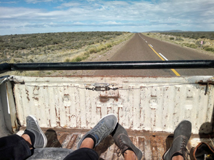 Hitching a ride from Trelew to Esquel, Argentina, on the back of a farmer's truck watching the pampas fly by.