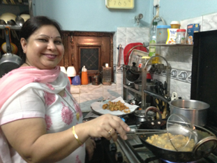 Delhi woman preparing dinner for travelers