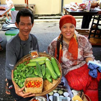 Ibu Dar selling fresh jams and vegetables at the organic market in Milas restaurantYogyakarta