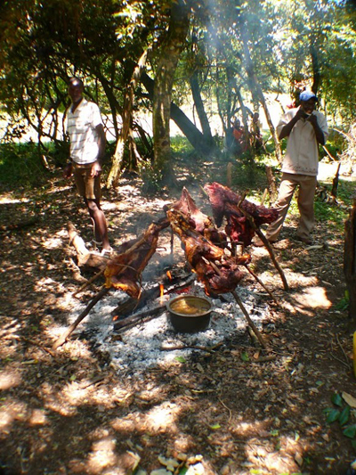 Grilling meat in the jungle with Maasai men. Rene Bauer photos.