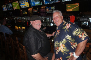Regulars enjoy the big screen TVs at Tony P's on the water