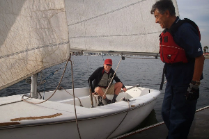 Cesar Jara rigs up our sailboat in Marina del Rey.
